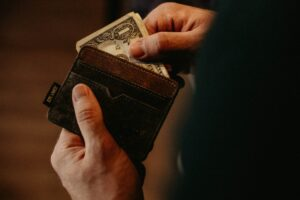 man pulling from wallet